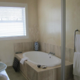 Pandora bathroom with separate bath and shower